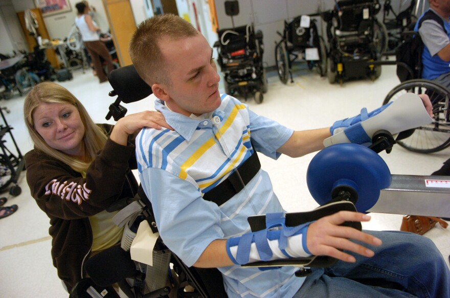 Matt Keil participates in physical therapy during a BeFit class at Craig Hospital in Englewood, Colo., in 2007.