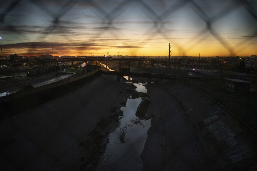 The Rio Grande is seen at dawn atop the Paso del Norte International Bridge on March 26 in Ciudad Juárez in the state of Chihuahua, Mexico. Both Ciudad Juárez and its sister city El Paso, Texas, have put in place stay-at-home orders.