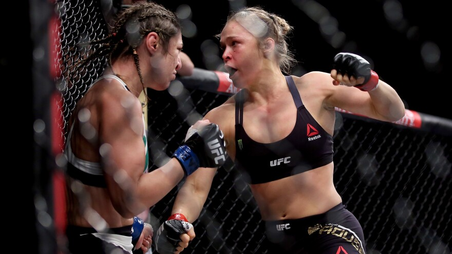 Ronda Rousey (right), mid-fight with Bethe Correia. This bout didn't last much longer after the photo was taken. It didn't last very long, period.