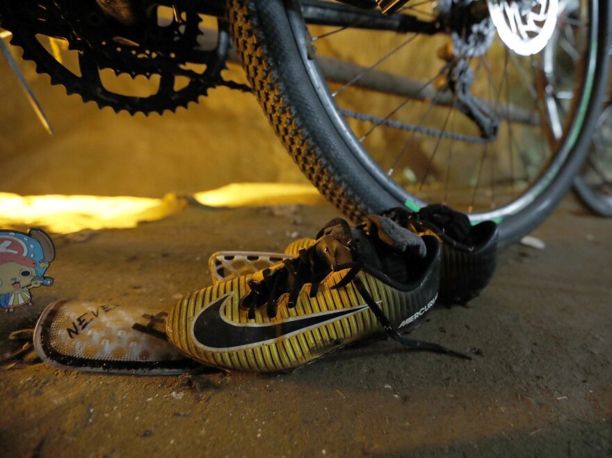 Soccer shoes were found next to bicycles outside the main entrance to the Tham Luang Nang Non cave in Northern Thailand.