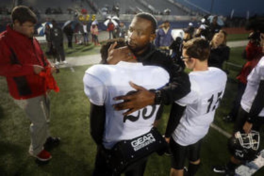 Gainesville coach Roy Burns hangs state finalist medals on all of his players with a personal message.