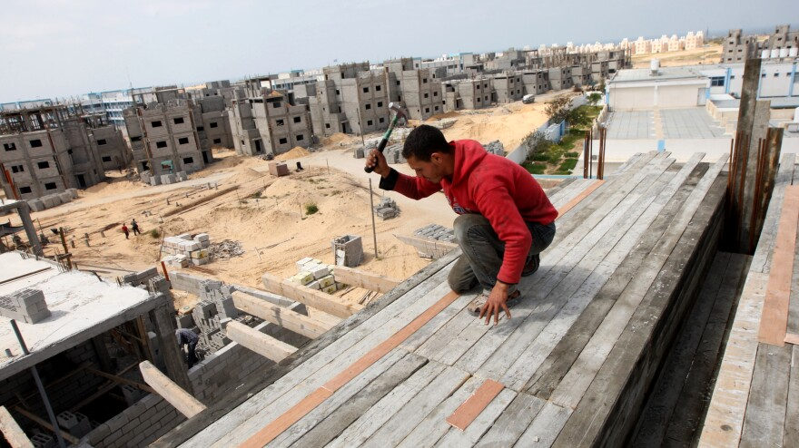 A Palestinian laborer works at the site of a residential construction project funded by the United Nations Relief and Works Agency for Palestine Refugees in Rafah, in the southern Gaza Strip, on Mar. 21, 2012.