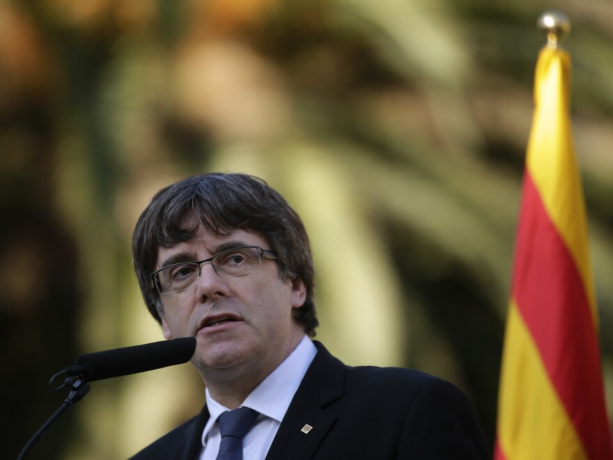 Catalan regional President Carles Puigdemont addresses the media after a ceremony commemorating the 77th anniversary of the death of Catalan leader Lluis Companys at the Montjuic Cemetery in Barcelona, Spain, on Sunday.