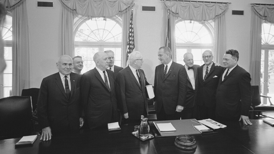 The Warren Commission delivers its report on Kennedy's assassination to President Lyndon B. Johnson in the Cabinet Room of the White House on Sept. 24, 1964. From left: lawyer John McCloy, General Counsel J. Lee Rankin, Sen. Richard Russell, Rep. Gerald Ford, Chief Justice Earl Warren, President Johnson, former CIA Director Allen Dulles, Sen. John Sherman Cooper, and Rep. Hale Boggs.