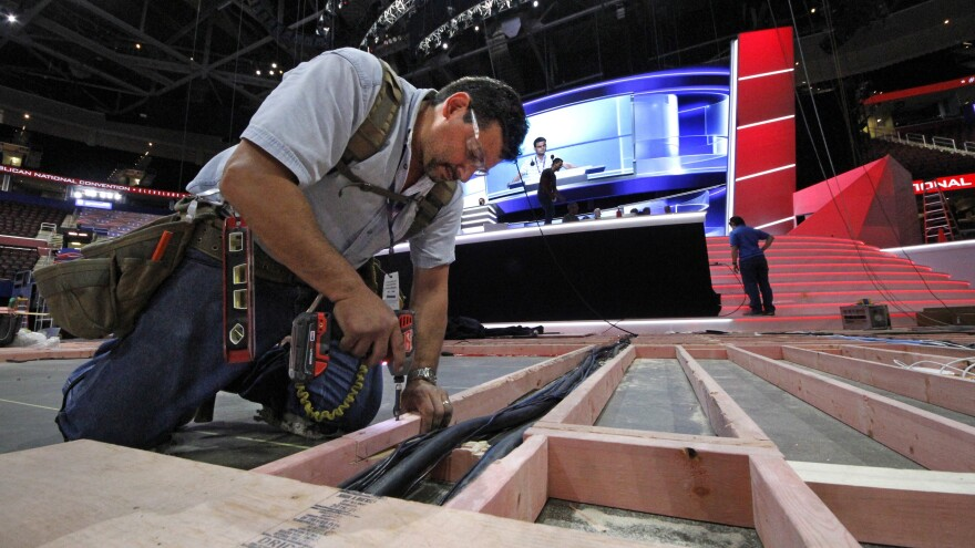 Carpenter Bill Kaim of Cleveland, works on the convention floor at the Quicken Loans Arena in downtown Cleveland, Ohio, in preparation for the upcoming Republican National Convention Wednesday, July 13, 2016. (AP Photo/Gene J. Puskar)