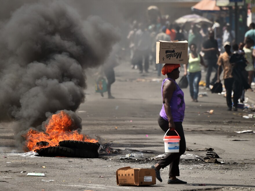 A tire placed by a small group of demonstrators burns on a street in the Pétion-Ville area of the Haitan capital Port-au-Prince, on Feb. 17.