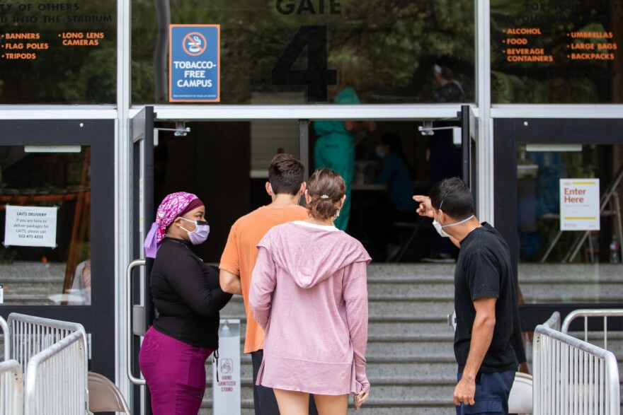 UT Austin students wait in line to be tested for COVID-19 at DKR Stadium before the Sept. 12 football game against UT-El Paso.