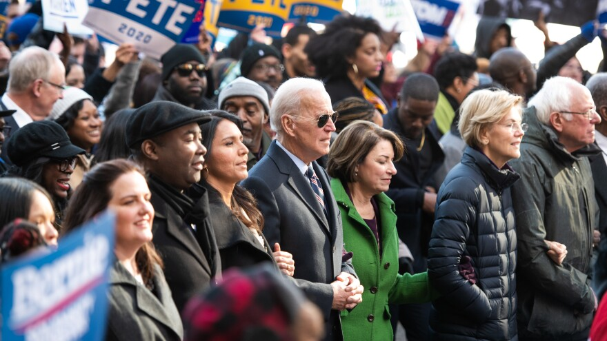 From left: Democratic presidential candidates Hawaii Rep. Tulsi Gabbard, Biden, Minnesota Sen. Amy Klobuchar, Massachusetts Sen. Elizabeth Warren and Sanders march to the King Day at the Dome event on Monday in Columbia, South Carolina.