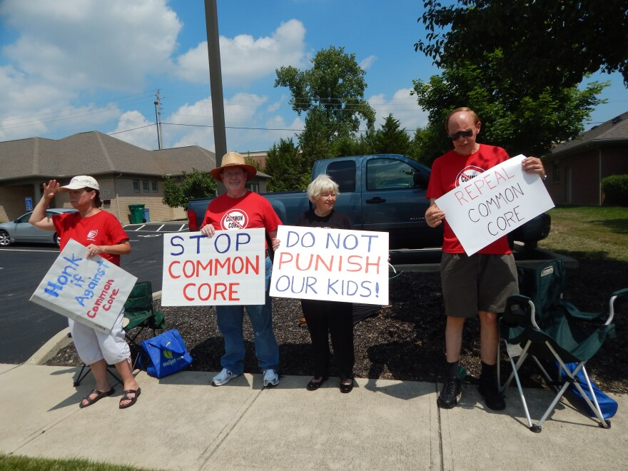 A group affiliated with the Greene County Tea Party gathered outside Signs Now, where Governor Kasich stopped in on Tuesday.