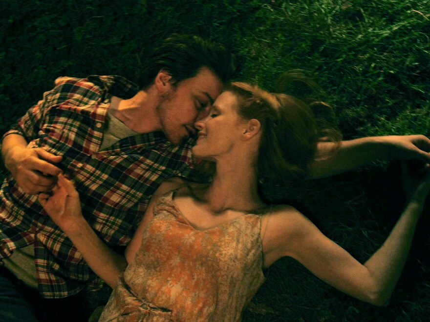The film may have scenes in common — like this one in which the couple, played by James McAvoy and Jessica Chastain, cuddles on the grass in a park — but each version carries a different mood.