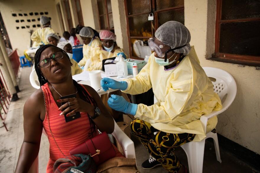 Rehema Kabuo of Goma gets an Ebola vaccination.