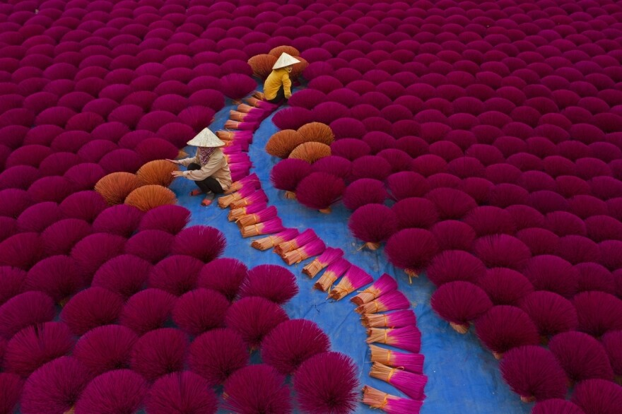 Workers gather incense sticks into bundles at a village near Hanoi, Vietnam.<strong> </strong>