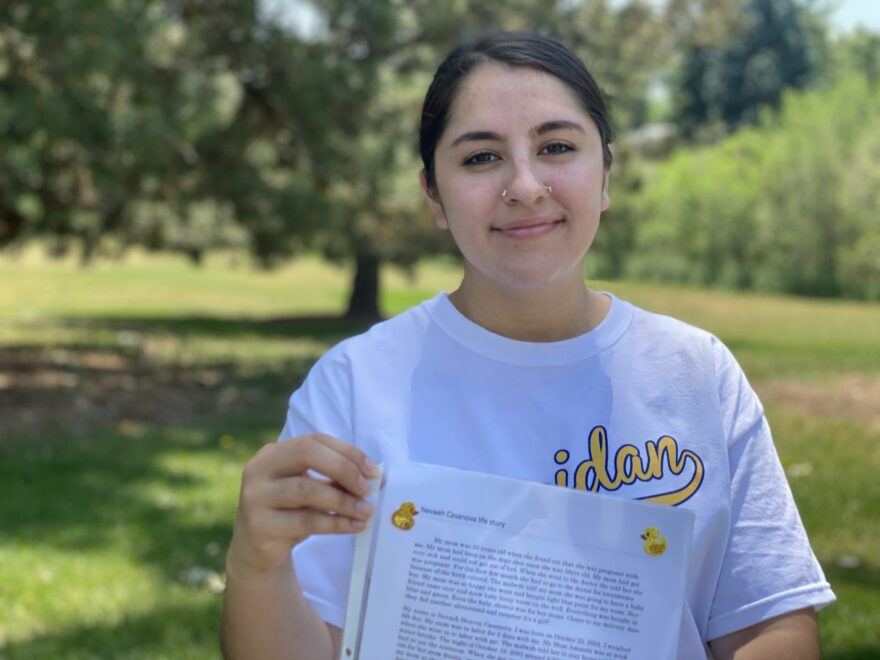 Nevaeh Casanova holds up an essay about her life, something she was asked to write when she was put in a diversion program five years ago. Around that time, the city connected her with a summer job at the Boys & Girls Club.