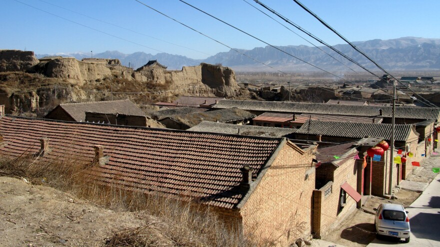 The beige soil around Nuanquan Town is made up of compacted dust. The area lies outside the Great Wall, and for centuries was a frontier region where the ethnic Han people fought, traded and mixed with nomadic tribes of the Central Asian Steppe.
