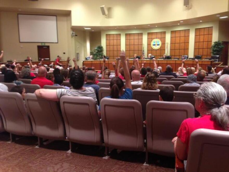 Testing opponents quietly show support for speakers at Tuesday's Lee County school board meeting. The board voted 3-2 to reverse its state testing boycott.
