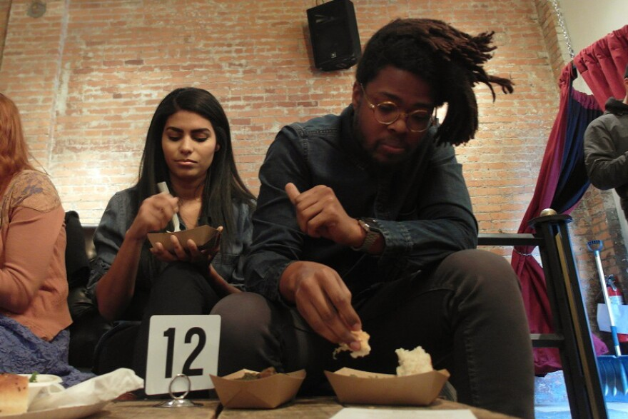 Norris Howard (right) and Latasha James attended the Peace Meal Kitchen pop-up in Detroit on Saturday in support of immigrants impacted by the travel ban.