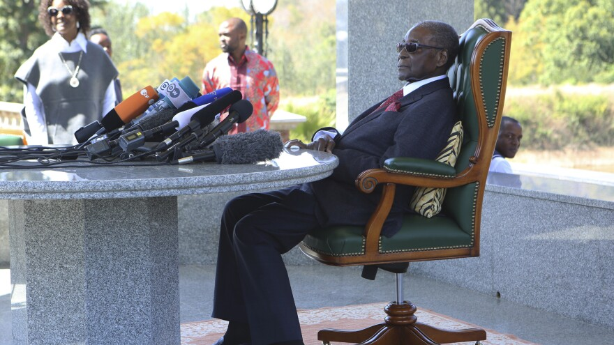 Former Zimbabwean President Robert Mugabe holds a press briefing at his residence on Sunday, on the eve of the country's elections.