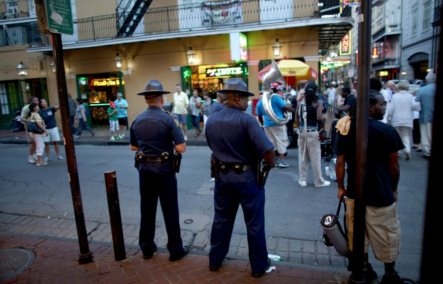 Officers with the Louisiana State Police patrol in New Orleans' French Quarter. Ordinary residents feel their neighborhoods need more protection, and they are frustrated by stepped-up efforts in key tourist areas such as the French Quarter.