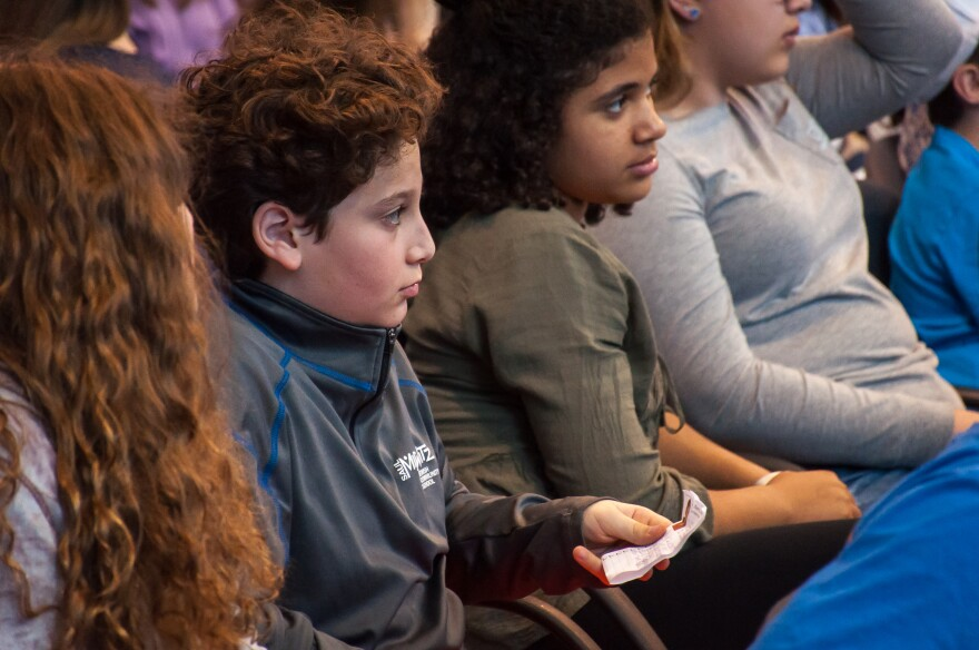 Seventh-grader Max Lagoy, 12, asks Chelsea Clinton a question during her talk Friday, April 7, to students at Mirowitz Jewish Community School.