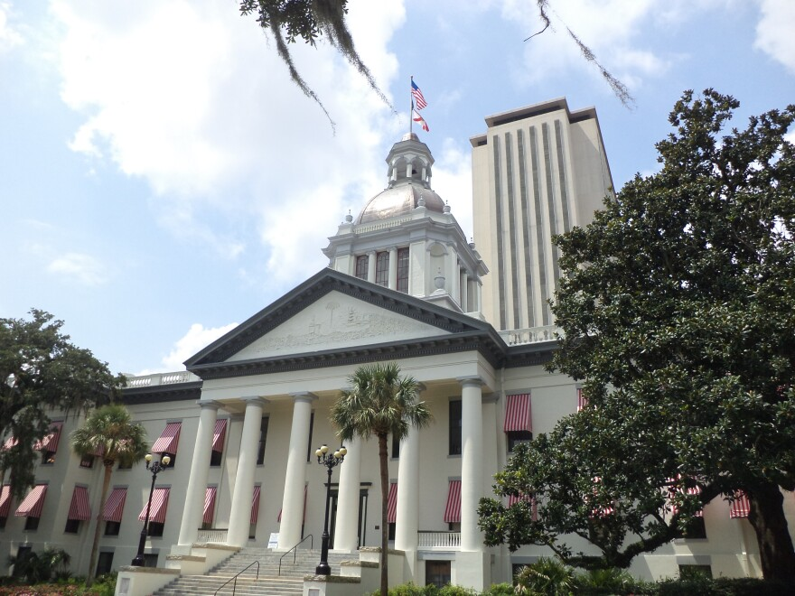 Florida's historic Capitol is pictured with the current Capitol Building in the background.