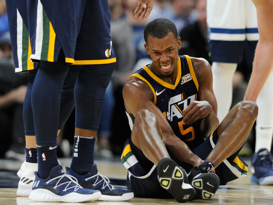 Utah Jazz player Rodney Hood injured his ankle during a game against the Minnesota Timberwolves earlier this year. Pain management in sports sometimes involves medications and their attendant risks.