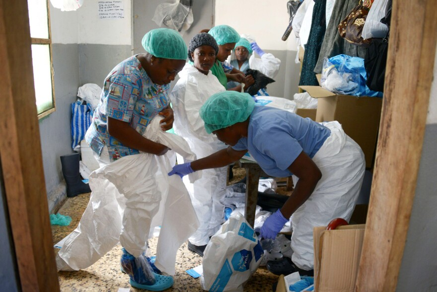 Medical workers at the John F. Kennedy Medical Center in Monrovia, Liberia, put on their protective suits before going to the high-risk area of the hospital, where Ebola patients are being treated, Sept. 3.