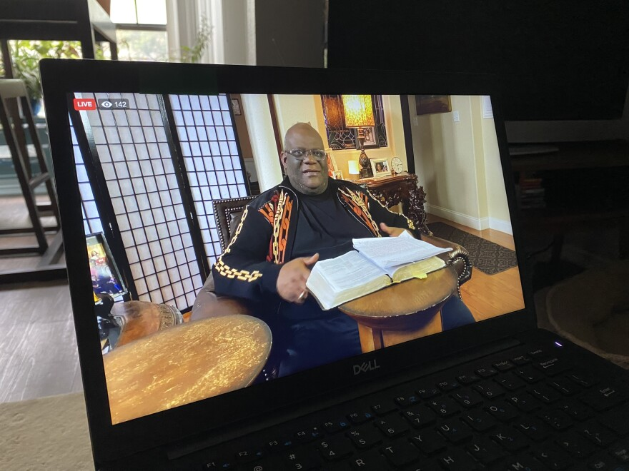 Cornerstone Baptist Church in Arlington is getting used to meeting up online during the pandemic. Senior pastor Dwight McKissic photographed on a laptop.