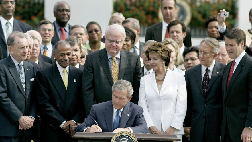In 2006, then-President George W. Bush signs the reauthorization of the Voting Rights Act, on the South Lawn of the White House.