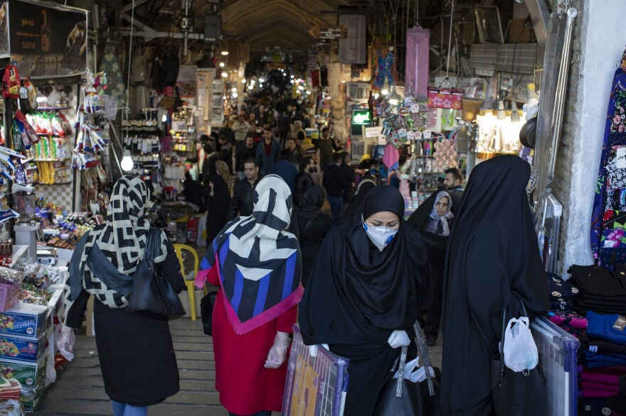 Ahead of the Iranian new year, Tehran's Grand Bazaar is relatively empty as costumers stay away amid fears of being infected with the coronavirus. Others take precautions by wearing gloves and masks.