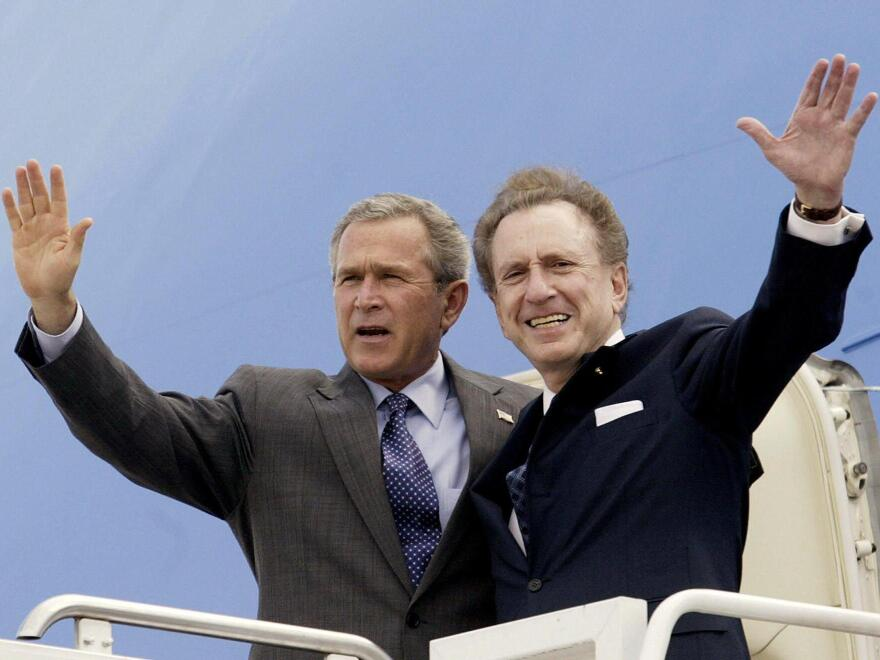 President George W. Bush and Specter arrive at Harrisburg International Airport in Pennsylvania on April 19, 2004.