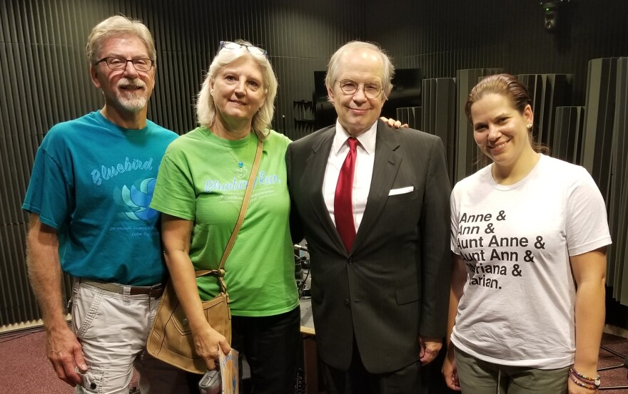 Tom flanagan and three guests standing in studio