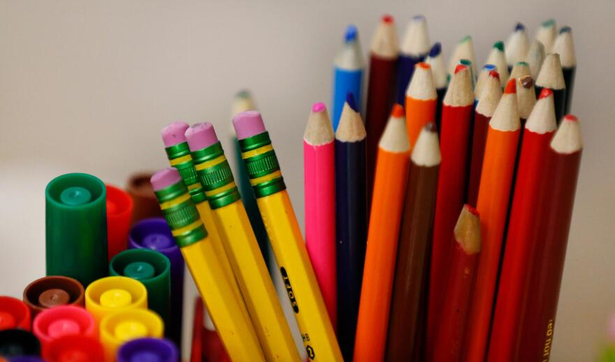 Pencils, markers and school supplies.