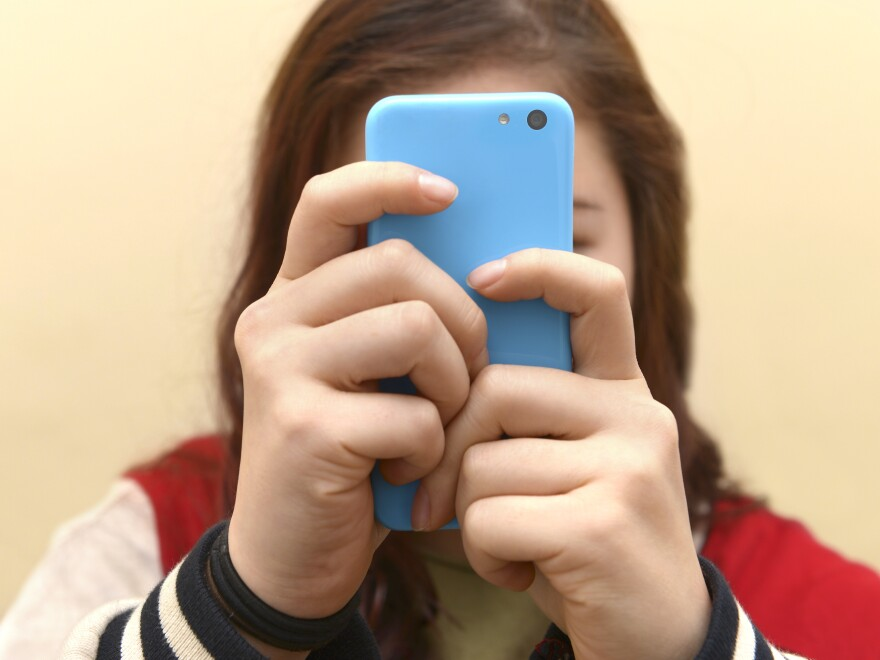 Close up of a teenager on her smartphone.
