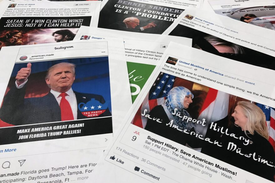 Some of the Facebook and Instagram ads linked to a Russian effort to disrupt the American political process during the 2016 election and stir up tensions around divisive social issues, released by members of the U.S. House Intelligence committee, are photographed in Washington. (AP Photo/Jon Elswick, File)