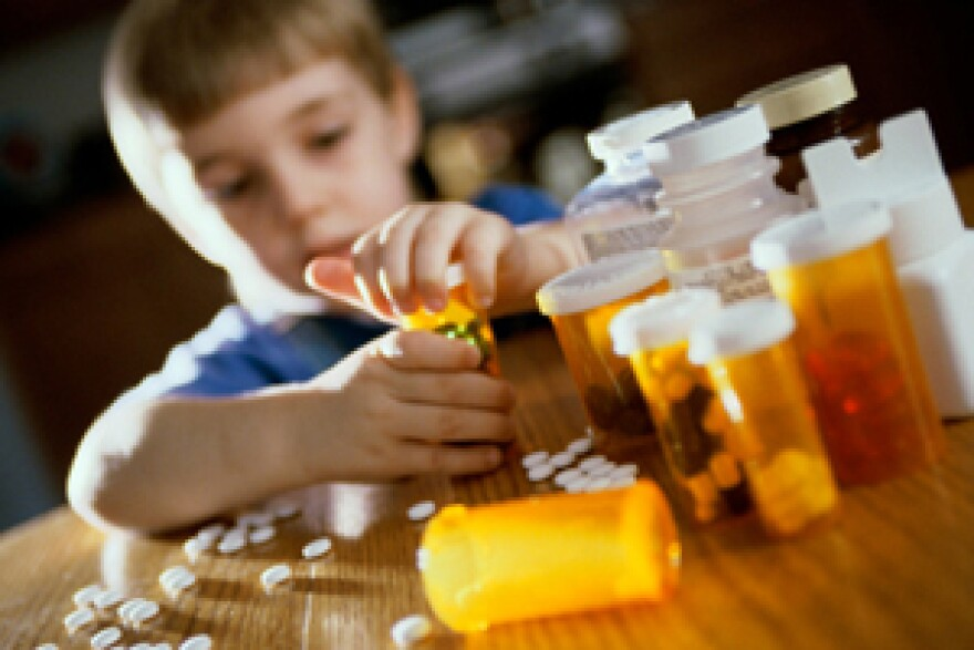 boy-opening-medicine-bottles.jpg