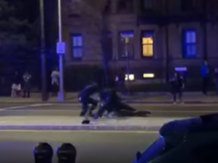 Bystander video captured an incident in which police in Cambridge, Mass., are seen punching a black Harvard student who was naked in the median.