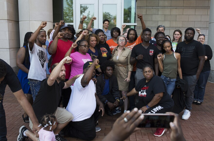 Supporters pose for photos after calling for clemency for Joshua Williams in August outside the Buzz Westfall Justice Center.