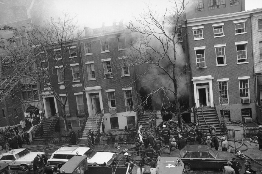 New York City firefighters work to put out a fire caused by explosions at 18 W. 11th St. on March 6, 1970. It was later discovered that the Weathermen, a radical left-wing organization, had been building bombs in the building's basement.
