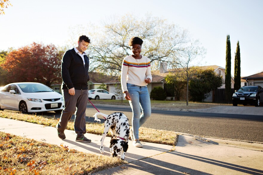 Andrew and Robi walk their puppy, Libby. The pandemic undercut both of their careers. Robi has relied on unemployment benefits since May and Andrew leaned into his work at a restaurant.