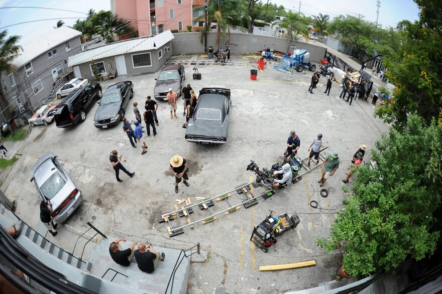 """Bird's eye view of """"Graceland"""" cast and crew filming on location in South Florida"""