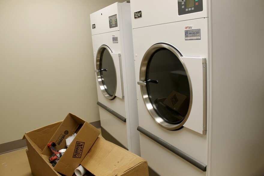 Two industrial washers and dryers will allow Biddle to wash sheets, towels and the clothes of people who are homeless.