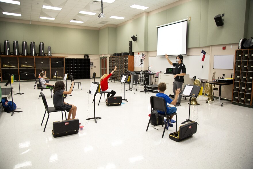 Stone Wang teaches band at Walsh Middle School in Round Rock.