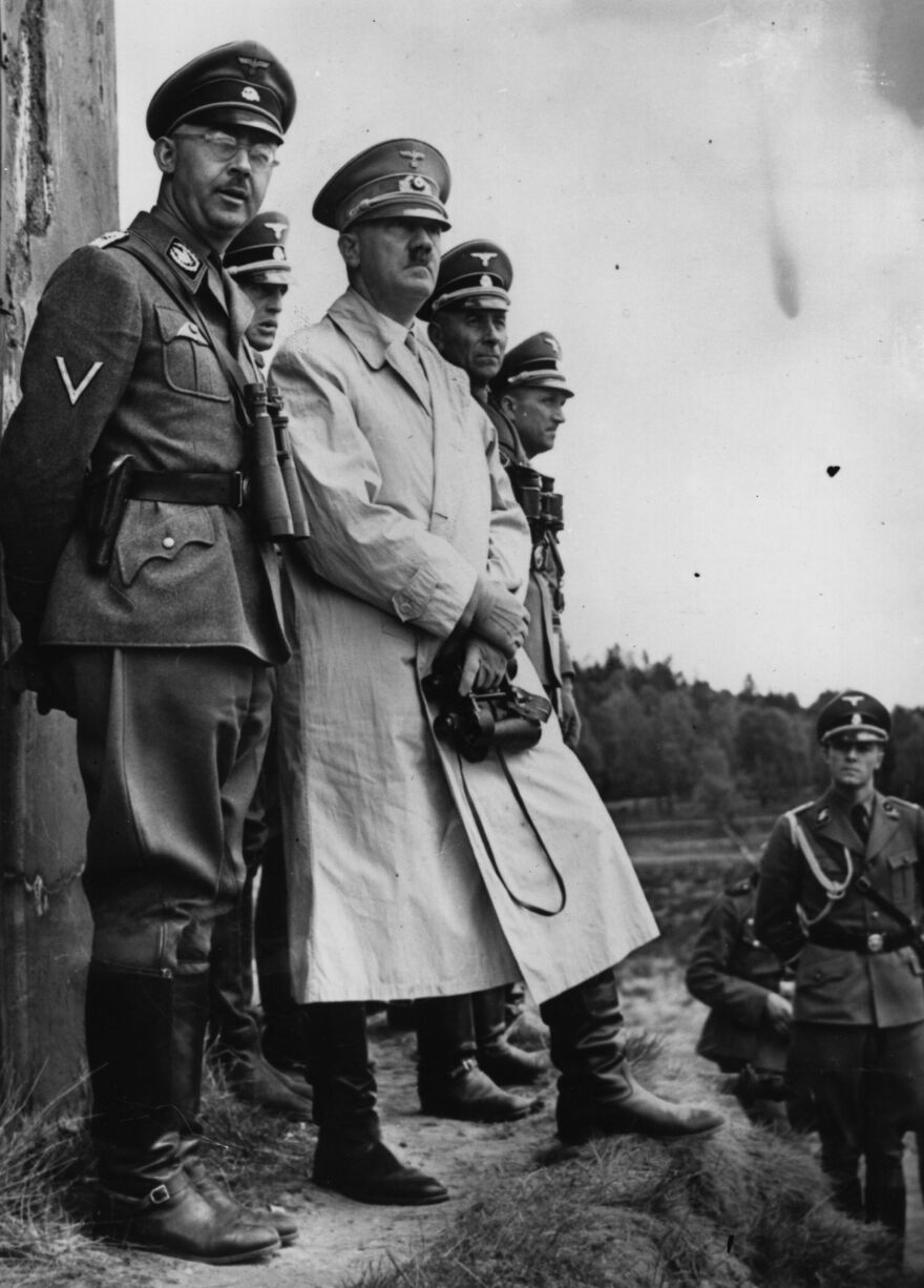 Heinrich Himmler (left) and Adolf Hitler (third from left) observe Stormtroop maneuvers in January 1941.
