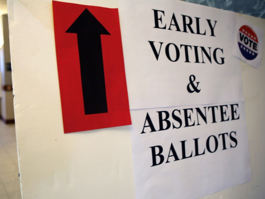 A sign directs voters to an area where they can cast their ballot in Scarborough, Maine, in 2009. Until recently, Maine voters could register to vote on Election Day but a new law has eliminated that option.
