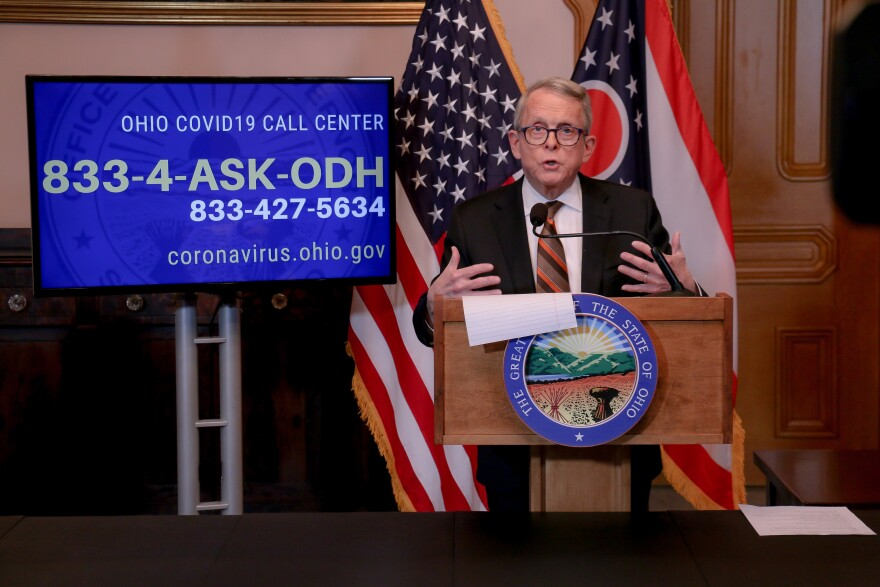 Gov. Mike DeWine gestures at his daily news conference on March 25, 2020.