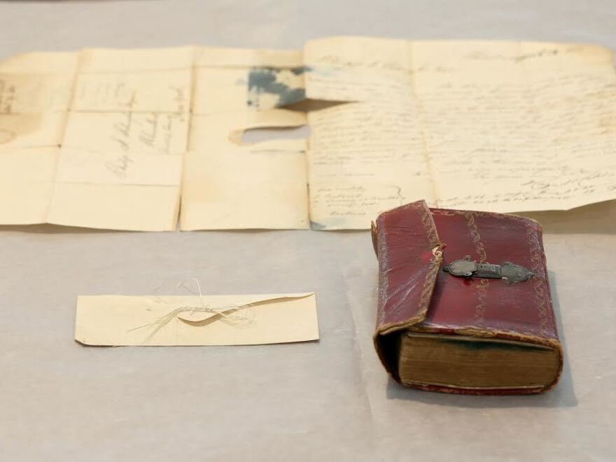 Union College says the hair was found in an envelope tucked between the pages of a 1793 leather almanac.
