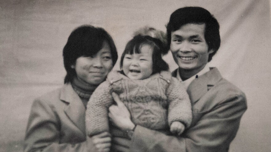 Director Nanfu Wang's <em>One Child Nation </em>documentary draws on her own family's experience with the restrictive policy. She's pictured here as a child with her parents.