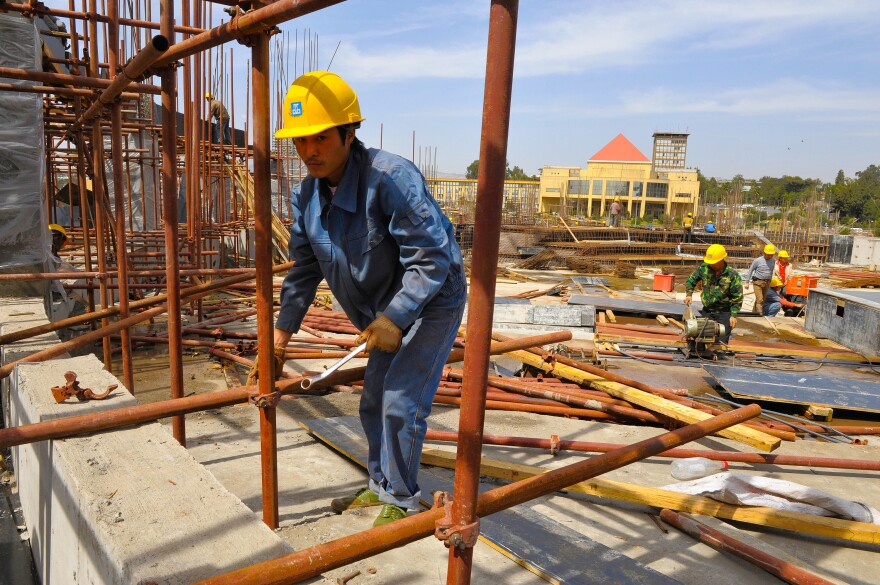 Workers from a Chinese engineering company erect the African Union conference center in Addis Ababa, Ethiopia, in 2010. China paid for the $200 million building as a gift to African Union.