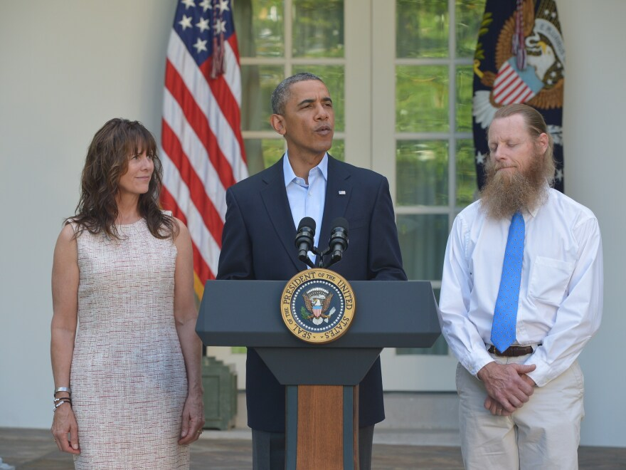 President Obama speaks in the White House Rose Garden Saturday with the parents of freed American soldier Bowe Bergdahl, Bob and Jani Bergdahl.