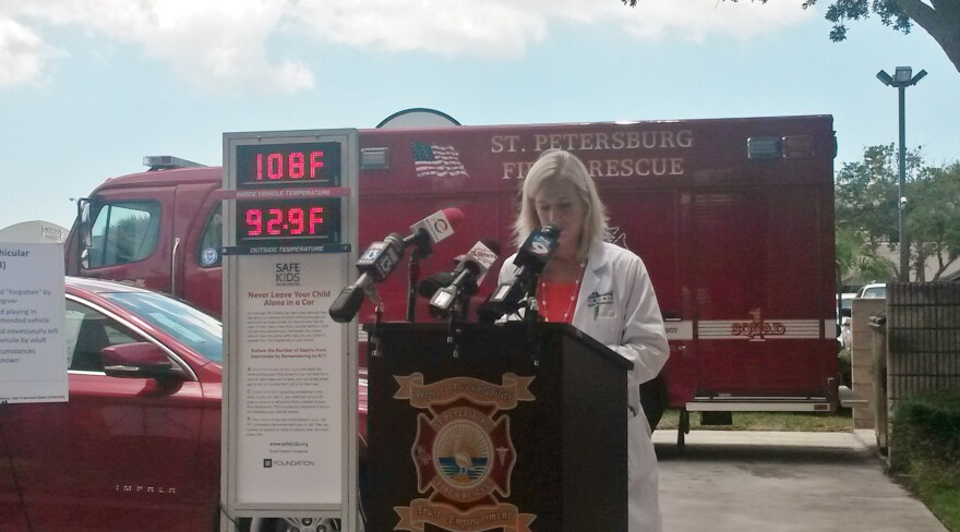 Dr. Beth Walford, a pediatric surgeon at All Children's Hospital, discusses the effects of heatstroke in children at a St. Petersburg Fire and Rescue and Suncoast Safe Kids Coalition event in June 2014.